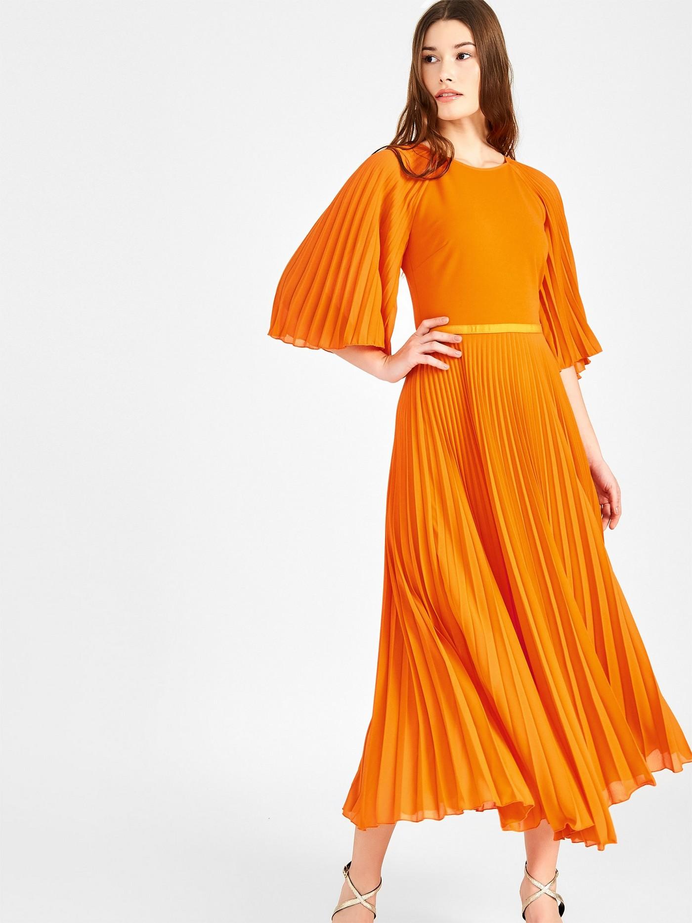 Стільна сукня італійського бренду Rinascimento, спідниця плісе.
